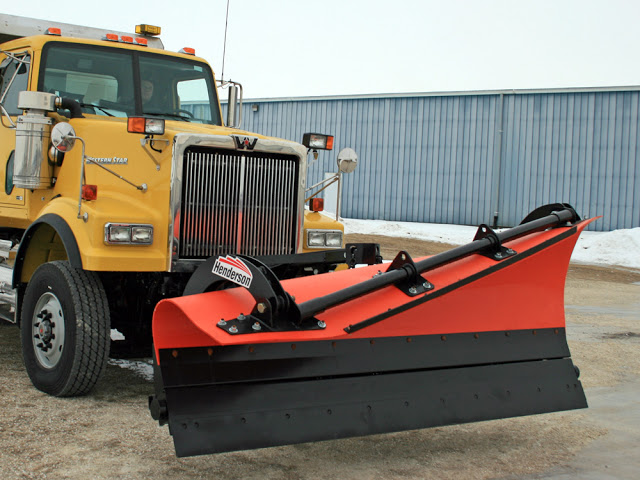 Truck with a Henderson RSP Flex 4 plow.