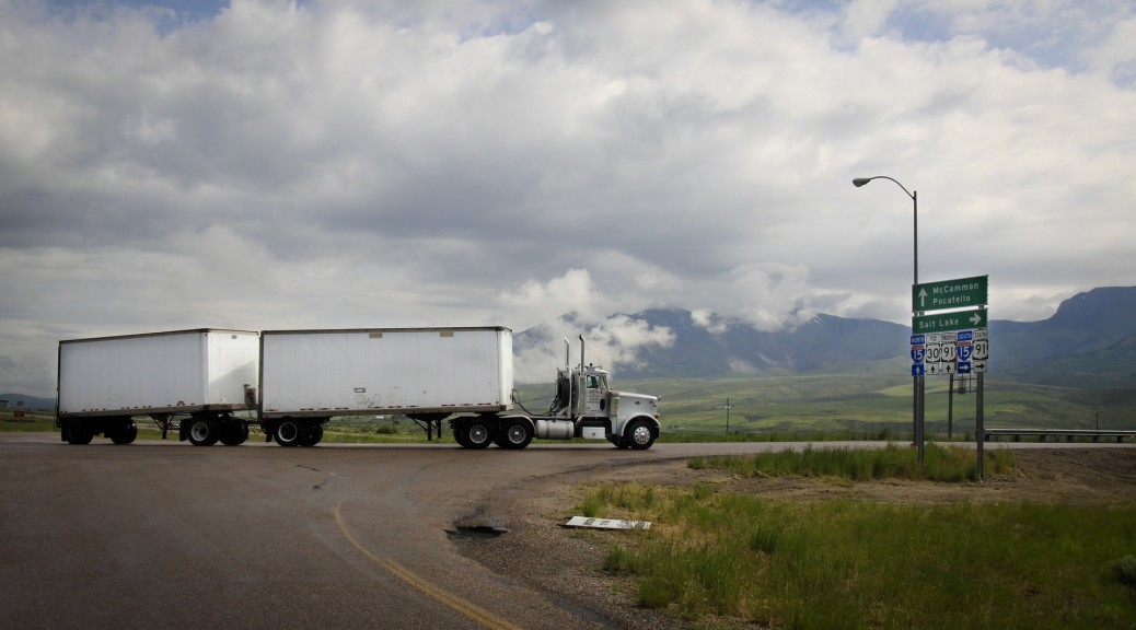 Semi-truck using a dolly to pull doubles in Utah.